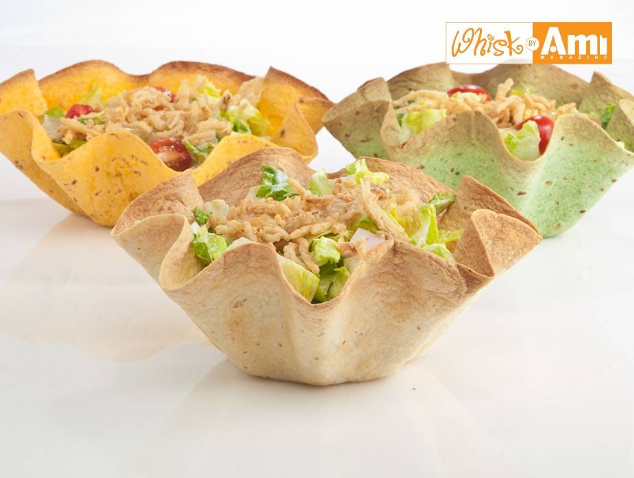 Caesar Salad with Crispy Onions in Tortilla Bowls
