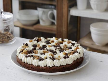 Gluten Free Brownie Cake with Cream, Truffles, and Caramelized Nuts