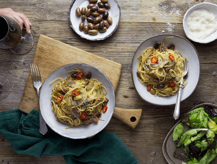 Pasta with Caramelized Onions, Mixed Olives, and Parmesan
